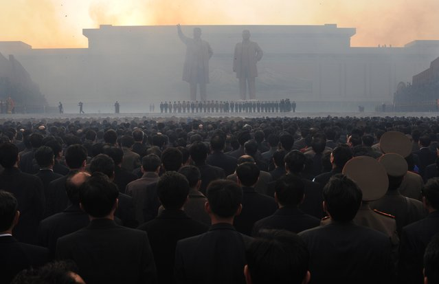 North Koreans watch fireworks during an unveiling ceremony of two statues of former leaders Kim Jong-Il (R) and Kim Il-Sung (L) in Pyongyang on April 13, 2012. (Photo by Pedro Ugarte/AFP Photo)