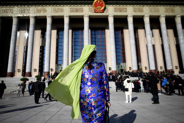 An ethnic minority delegate arrives for the third plenary meeting of the second session of the 13th National People's Congress (NPC) at the Great Hall of the People in Beijing on March 12, 2019. (Photo by Wang Zhao/AFP Photo)