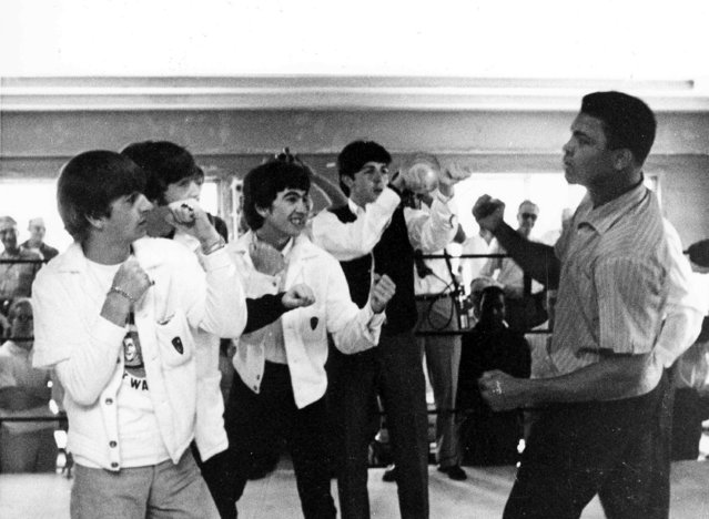 The Beatles, from left, Ringo Starr, John Lennon, George Harrison, and Paul McCartney spar up to Cassius Clay while visiting the heavyweight contender at his training camp in Miami Beach, Fla., February 18,1964. (Photo by AP Photo/stf)