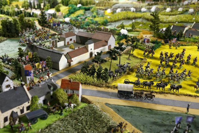 The Mont-Saint-Jean farm is seen near figurines representing soldiers of the British army on a 40-square-metre miniature model of the June 18, 1815 Waterloo battlefield, in Diest, Belgium, in this picture taken on April 29, 2015. Waterloo enthusiast Willy Smout said he spent 40,000 hours and around 150,000 euros over the past 40 years, to recreate the battlefield as closely as possible in a purpose-built room in his house. (Photo by Francois Lenoir/Reuters)