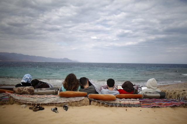 Israeli tourists at a beach in the Red Sea of the Gulf of Aqaba near Nuweiba, Sinai Peninsula, Egypt, 01 March 2019. Many Israelis travel to relax at the beaches of Sinai Peninsula despite the warnings of Israel's National Security Council, which defines Sinai as a high target for terrorist attacks against Israelis. (Photo by Abir Sultan/EPA/EFE)