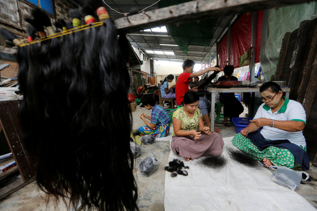 Workers clean the hair for export at Tet Nay Lin Trading Co. in Yangon, Myanmar, June 19, 2018. (Photo by Ann Wang/Reuters)