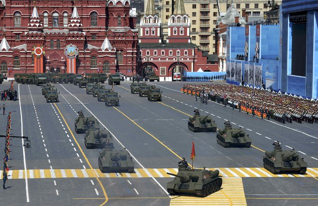 Soviet SU-100 tank destroyers drive during the Victory Day parade at Red Square in Moscow, Russia, May 9, 2015. (Photo by Reuters/Host Photo Agency/RIA Novosti)
