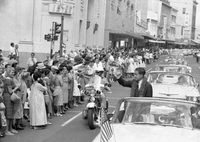 In this September 22, 1960, photo, Japanese Crown Prince Akihito rides in a motorcade from Honolulu International Airport to the Royal Hawaiian Hotel in Waikiki, Hawaii during a state visit to the U.S. When he abdicates April 30, 2019, Akihito will become the first emperor in Japan's modern history to see his era end without ever having a war. (Photo by AP Photo)