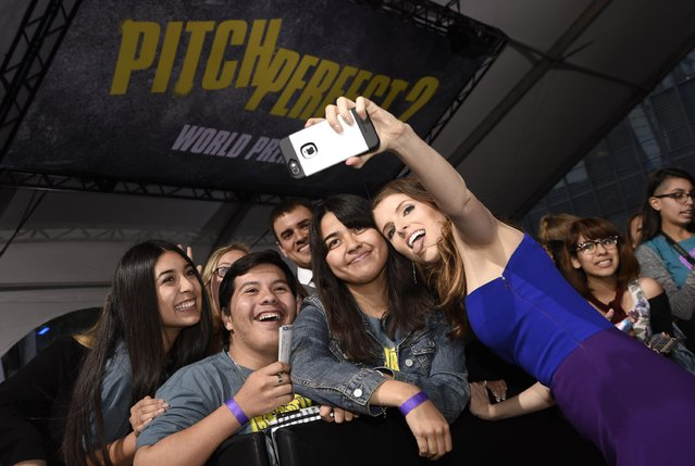 """Anna Kendrick takes a selfie with a fan at the world premiere of """"Pitch Perfect 2"""" at Nokia Theatre L.A. Live on Friday, May 8, 2015, in Los Angeles. (Photo by Chris Pizzello/Invision/AP Photo)"""