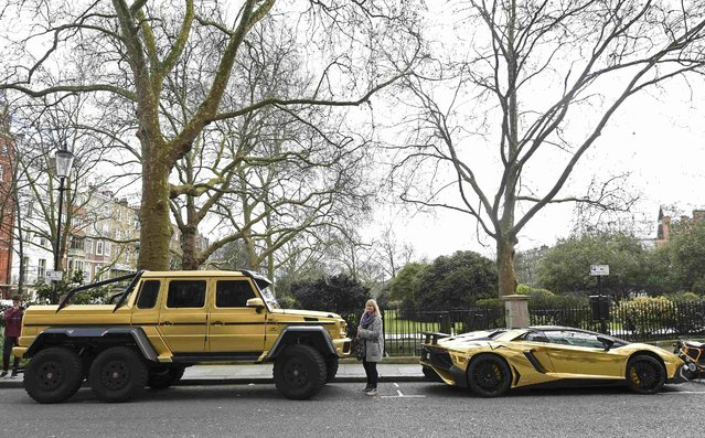Performance cars with a gold wrap finish are seen parked in a street in Knightsbridge in London, Britain March 31, 2016. (Photo by Toby Melville/Reuters)