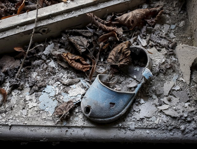 A shoe for children is left in a kindergarten in the abandoned city of Pripyat near the Chernobyl nuclear power plant in Ukraine on March 28, 2016. (Photo by Gleb Garanich/Reuters)