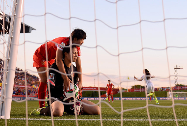 Fei Wang of China looks dejected after Carli Lloyd of USA scored the first goal during the FIFA Women's World Cup 2015 Quarter Final match between China and United States at Lansdowne Stadium on June 26, 2015 in Ottawa, Canada. (Photo by Lars Baron – FIFA/FIFA via Getty Images)