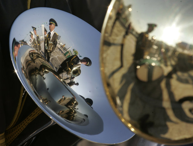 Members of a military band are reflected in a brass instrument at a ceremony following Kurbanguly Berdymukhamedov's inauguration as Turkmenistan's new president in Ashgabat February 14, 2007. (Photo by Gleb Garanich/Reuters)