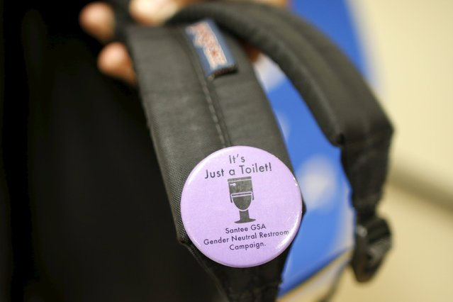A student displays a button made to campaign for the first gender-neutral restroom in the Los Angeles school district at Santee Education Complex high school in Los Angeles, California, U.S., April 18, 2016. (Photo by Lucy Nicholson/Reuters)