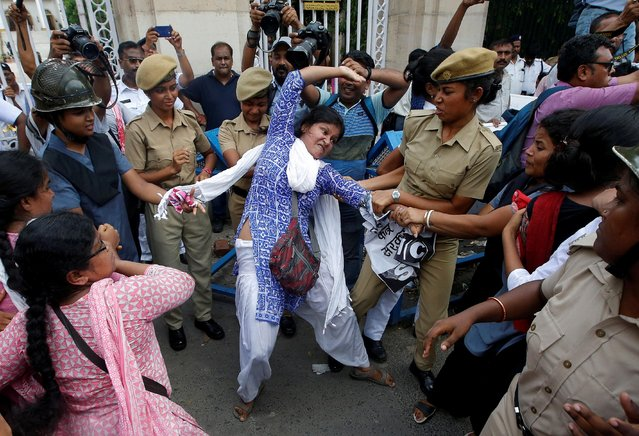 Police detain a demonstrator during a protest against the deaths of children who have died this month in Bihar, from encephalitis, commonly known as brain fever, in Kolkata, June 24, 2019. (Photo by Rupak De Chowdhuri/Reuters)