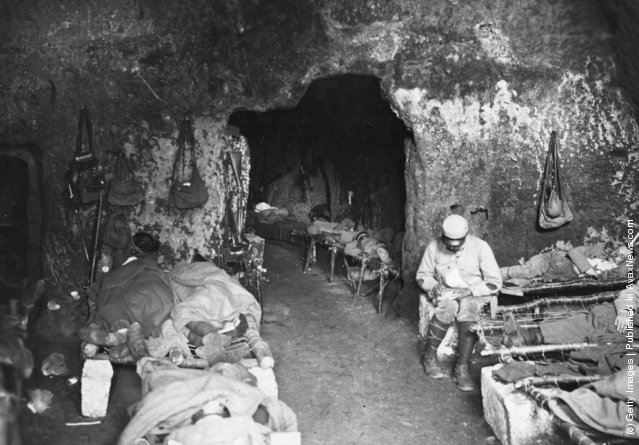 1914: Injured soldiers rest in a cave in France