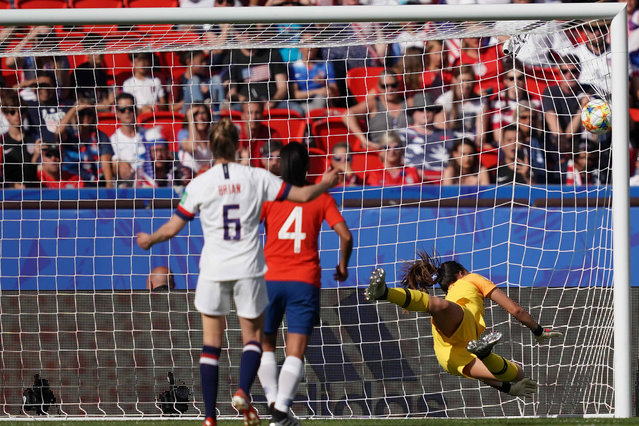 Chile's goalkeeper Christiane Endler concedes a goal during the France 2019 Women's World Cup Group F football match between USA and Chile, on June 16, 2019, at the Parc des Princes stadium in Paris. (Photo by Lionel Bonaventure/AFP Photo)