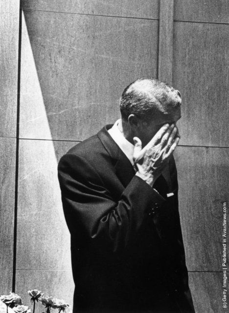 American baseball player Joe DiMaggio (1914 - 1999) wipes a tear from his eye after bursting into tears at the funeral of Marilyn Monroe in Westwood Memorial Park, Hollywood. He was the second of Monroe's three husbands