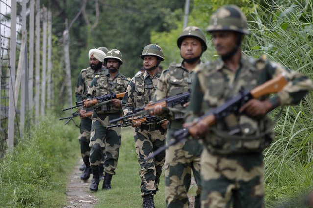 In this Tuesday, August 13, 2019 file photo, India's Border Security Force (BSF) soldiers patrol near the India Pakistan border fencing at Garkhal in Akhnoor, about 35 kilometers (22 miles) west of Jammu, India. Pakistan's prime minister assured Kashmiri people living in the Indian-administered part of the divided region that he supports them in their struggle for self-determination. In his statement Wednesday, Imran Khan condemned New Delhi's decision Aug. 5 to downgrade Kashmir's status, as he began celebrations marking Pakistan's independence day. (Photo by Channi Anand/AP Photo)