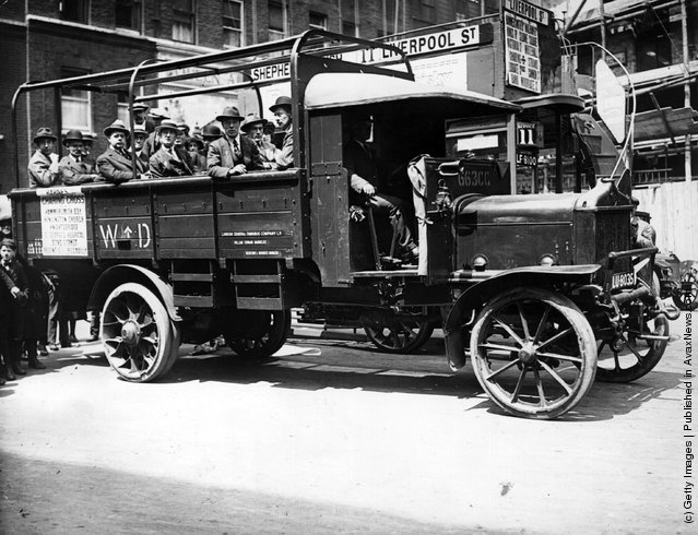 1919: Passengers on board a new London lorry bus, going from Shepherds Bush to Liverpool Street