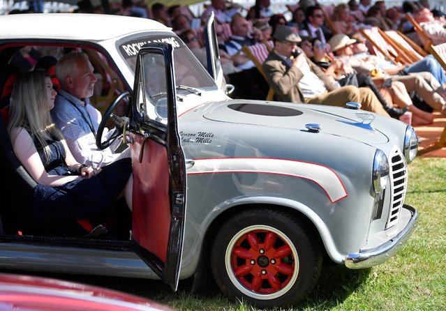 Motoring enthusiasts watch an open air film screening as they attend the Goodwood Revival, a three day classic car racing festival celebrating the mid-twentieth century heyday of the sport, at Goodwood in southern Britain, September 13, 2019. (Photo by Toby Melville/Reuters)