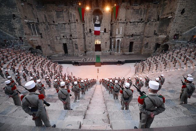 Soldiers of the French Foreign Legion stand guard during the rehearsal of the ceremony commemorating the battle of Camaron in the ancient theatre of Orange, France, April 29, 2014. The ceremony will mark the regiment's last public appearance in Orange before its move to its new base in Carpiagne. (Photo by Boris Horvat/AFP Photo)