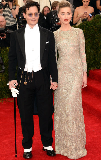 "Johnny Depp and Amber Heard attend the ""Charles James: Beyond Fashion"" Costume Institute Gala at the Metropolitan Museum of Art on May 5, 2014 in New York City. (Photo by Jamie McCarthy/FilmMagic)"