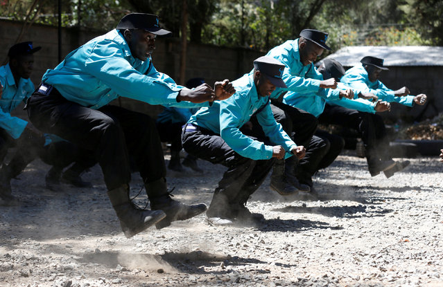 Kenyan security guards participate in physical exercise during martial arts combat training at the Chinese-run Deway Security Group compound in Kenya's capital Nairobi, March 13, 2017. (Photo by Thomas Mukoya/Reuters)