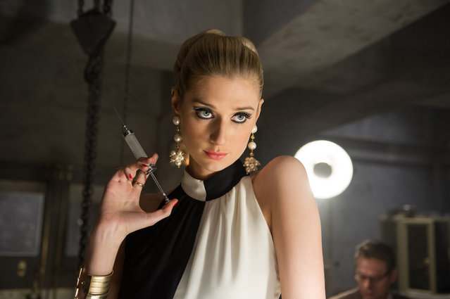 """This photo provided by Warner Bros. Pictures shows Elizabeth Debicki as Victoria in Warner Bros. Pictures' action adventure """"The Man from U.N.C.L.E."""", a Warner Bros. Pictures release. The movie, directed by Guy Ritchie, opens in U.S. theaters on August 14. (Photo by Daniel Smith/Warner Bros. Pictures via AP Photo)"""