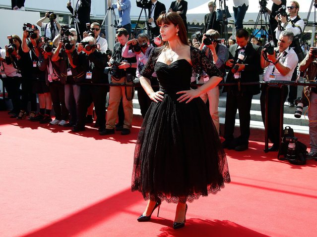 """Italian actress Monica Bellucci poses as she arrives for the screening of the film """"Le Meraviglie (The Wonders)"""" at the 67th edition of the Cannes Film Festival in Cannes, southern France, on May 18, 2014. (Photo by Valery Hache/AFP Photo)"""