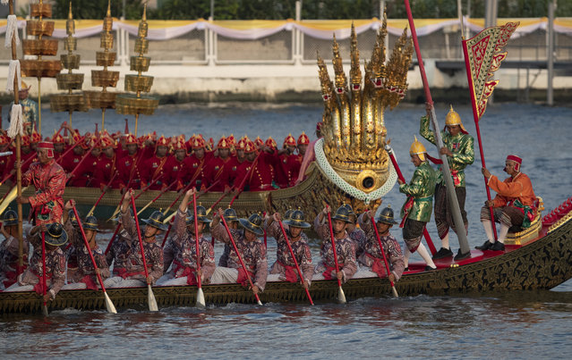 Oarsmen paddle their boat during the dress rehearsal for the Royal barge ceremony on the Chao Phraya river Bangkok, Thailand, Monday, October 21, 2019. The Royal barge procession is part of the coronation of Thailand's King Maha Vajiralongkorn and will be held on December 12. (Photo by Sakchai Lalit/AP Photo)