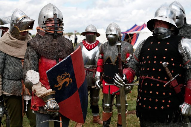 People wear armor as they attend a reenactment of the Battle of Agincourt, in Agincourt, northern France, Saturday, July 25, 2015. (Photo by Thibault Camus/AP Photo)