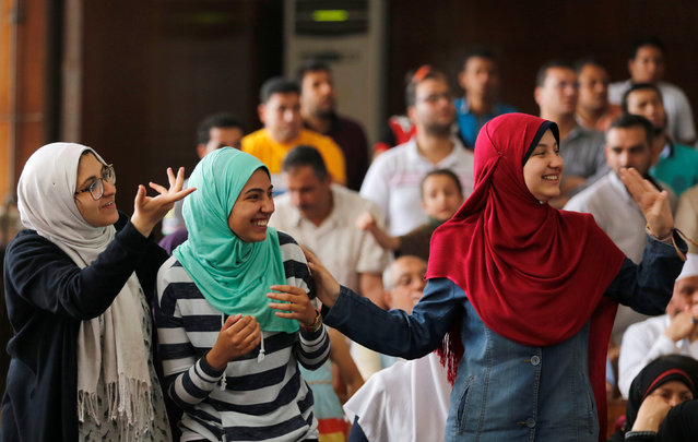 Family members and relatives of Muslim Brotherhood members, on trial for an armed sit-in at Rabaa square, wave and cheer them on at a court on the outskirts of Cairo, Egypt May 31, 2016. (Photo by Amr Abdallah Dalsh/Reuters)