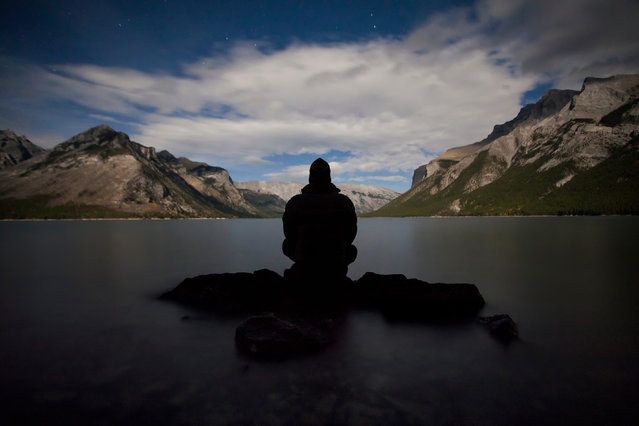 "Photographer Paul Zizka in ""At One"", Lake Minnewanka, Banff National Park, Alberta, Canada, October 1, 2012. (Photo by Paul Zizka/Caters News)"