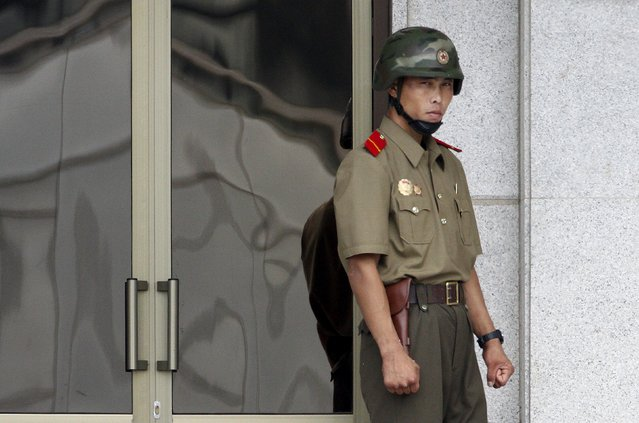 A North Korean soldier looks south from the North side at the truce village of Panmunjom, South Korea, July 22, 2015. North Korea has erected a new, taller launch tower at its missile base, possibly in preparation for firing a long-range rocket to mark an important national anniversary in October, South Korea's Yonhap news agency reported on Wednesday. (Photo by Kim Hong-Ji/Reuters)