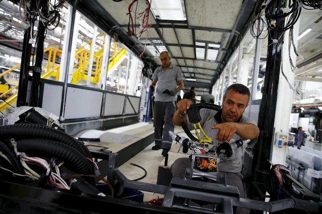 Employees work at the assembly line of the MAN Bus Production Center in Ankara, Turkey, July 29, 2015. (Photo by Umit Bektas/Reuters)
