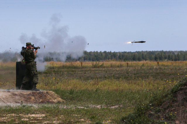 "A Russian paratrooper fires a weapon during the ""Paratrooper's platoon"" military game at a Dubrovichi shooting range outside of Ryazan, some 170 kms south east of Moscow, Russia, Tuesday, August 4, 2015.  (Photo by Ivan Sekretarev/AP Photo)"