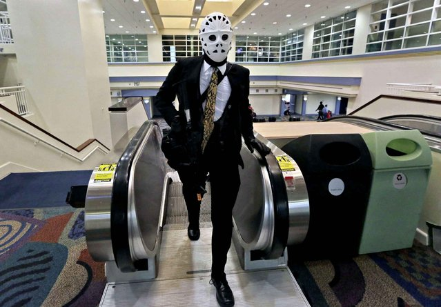 Frank Hernandez, 17, of Miami, wears a outfit depicting the character Waingrow from the film Heat, while attending Florida Supercon, Thursday, July 3, 2014, in Miami Beach, Fla. Supercon features comic books, anime, animation, video games, fantasy, Sci-Fi and pop culture at its' convention which runs July 3-6 at the Miami Beach Convention Center. (Photo by Lynne Sladky/AP Photo)