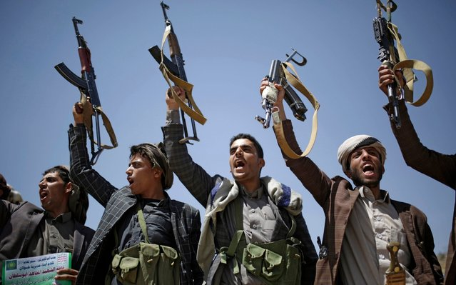 Shiite Houthi tribesmen hold their weapons as they chant slogans during a tribal gathering showing support for the Houthi movement, in Sanaa, Yemen, Saturday September 21, 2019. Yemen's Houthi rebels said late Friday night that they were halting drone and missile attacks against Saudi Arabia, one week after they claimed responsibility for a strike that crippled a key oil facility in the kingdom. (Photo by Hani Mohammed/AP Photo)