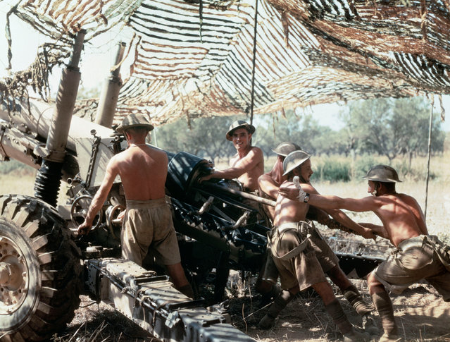 A 5.5-inch gun crew from 75th (Shropshire Yeomanry) Medium Regiment, Royal Artillery, in action in Italy, September 1943. (Photo by IWM/PA Wire)