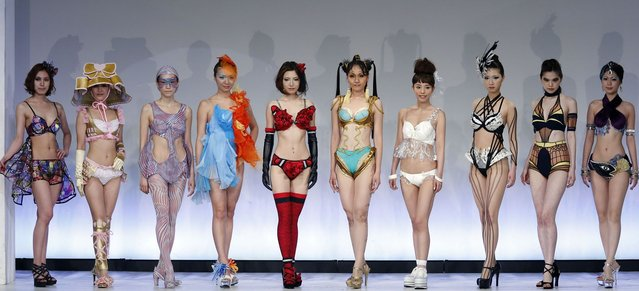 Models display lingerie designs in various themes as they pose at the Triumph Inspiration Award Japan at the Bunka Fashion College in Tokyo on May 30, 2012