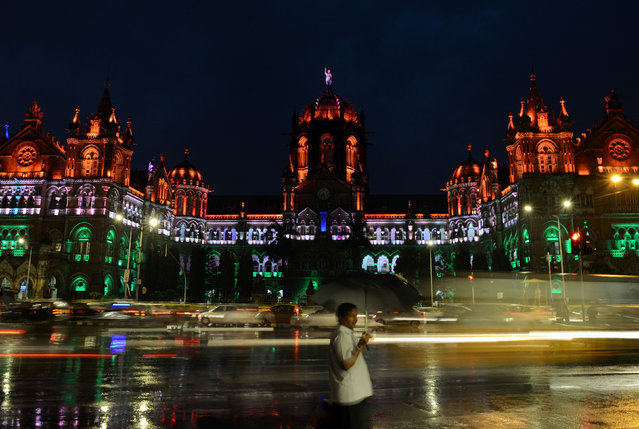 The Chattrapathi Shivaji Terminus (CST) railway station is lit in the colours of India' s flag ahead of the country' s Independence Day in Mumbai on August 14, 2017. Indian Independence Day is celebrated annually on August 15, and this year marks 70 years since British India split into two nations Hindu- majority India and Muslim- majority Pakistan and millions were uprooted in one of the largest mass migrations in history. (Photo by Punit Paranjpe/AFP Photo)