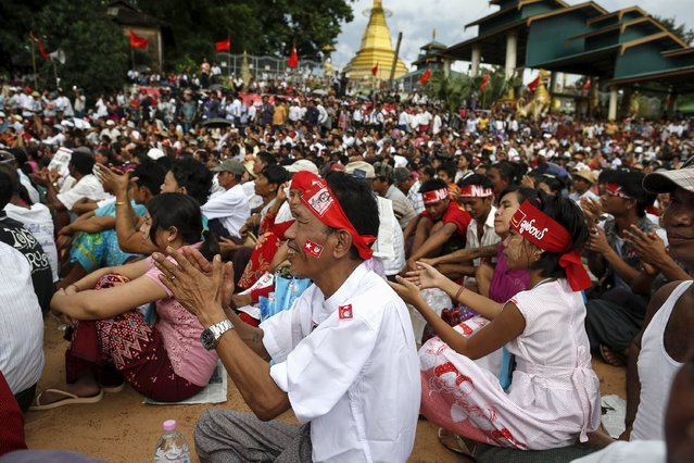 Supporters react as Myanmar pro-democracy leader Aung San Suu Kyi gives a speech on voter education at the Thanlyin township, outside Yangon August 21, 2015. (Photo by Soe Zeya Tun/Reuters)