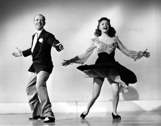 "In this undated photo, Fred Astaire and 18-year-old co-star Joan Leslie perform a dance routine from the 1943 movie ""The Sky's the Limit,"" in Los Angeles, Calif. Leslie, whose expressive almond eyes and innocent beauty made her one of the most popular film ingenues of the 1930s and 40s, has died at the age of 90. She died in Los Angeles on Monday, October 12, 2015, her family announced in an obituary. (Photo by AP Photo)"