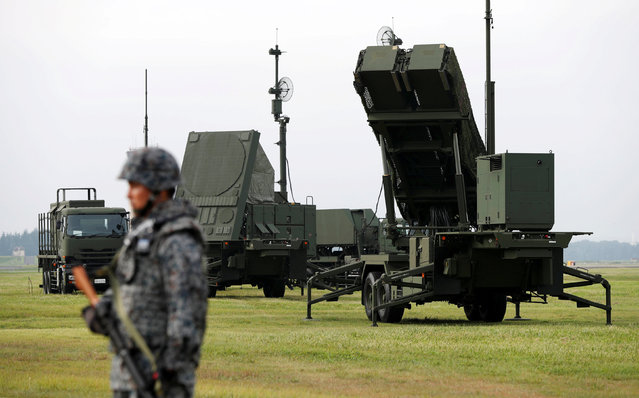 A Japan Self-Defense Forces (JSDF) soldier takes part in a drill to mobilise their Patriot Advanced Capability-3 (PAC-3) missile unit in response to a recent missile launch by North Korea, at U.S. Air Force Yokota Air Base in Fussa on the outskirts of Tokyo, Japan August 29, 2017. (Photo by Issei Kato/Reuters)