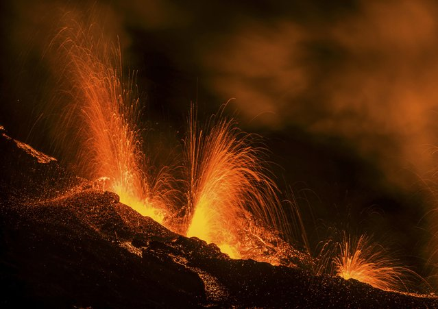 Molten lava erupts from the Piton de la Fournaise, one of the world's most active volcanoes, on the French Indian Ocean Reunion Island, August 25, 2015. (Photo by Gilles Adt/Reuters)