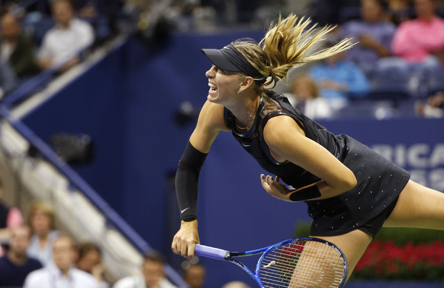 Maria Sharapova, of Russia, follows through on a serve to Sofia Kenin, of the United States, at the U.S. Open tennis tournament in New York, Friday, September 1, 2017. (Photo by Kathy Willens/AP Photo)