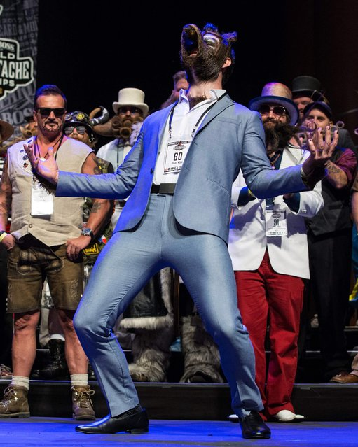 Isaiah Webb, Full Beard Freestyle 2nd place winner and the winner of the Big Joe Johnson Showmanship Award attends the 2017 Remington Beard Boss World Beard & Moustache Championships held at the Long Center for the Performing Arts on September 3, 2017 in Austin, Texas. (Photo by Suzanne Cordeiro/AFP Photo)