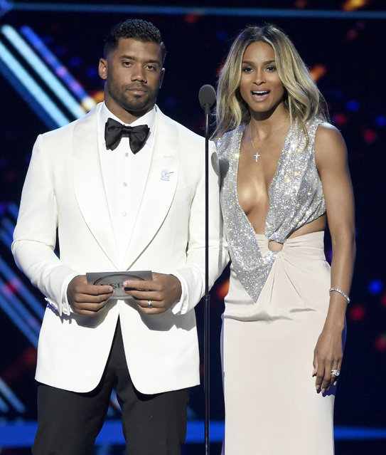 NFL football player Russell Wilson, left, and Ciara present the award for best record-breaking performance at the ESPY Awards at the Microsoft Theater on Wednesday, July 13, 2016, in Los Angeles. (Photo by Chris Pizzello/Invision/AP Photo)