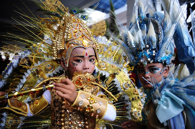 Models wear Mahabharata (L) and Stalagmite (R) costumes in the kids carnival during The 13th Jember Fashion Carnival 2014 on August 21, 2014 in Jember, Indonesia. (Photo by Robertus Pudyanto/Getty Images)