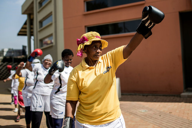 "The ""Boxing Gogos"" (Grannies) stretch as they take part in a session hosted by the A Team Gym in Cosmo City in Johannesburg on September 19, 2017. (Photo by Gulshan Khan/AFP Photo)"