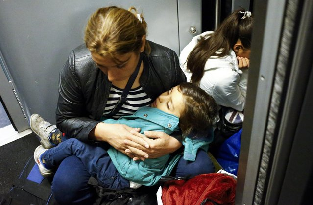 A migrant woman sits with her baby aboard a train to Vienna at the railway station in the town of Hegyeshalom, Hungary, September 5, 2015. (Photo by Leonhard Foeger/Reuters)