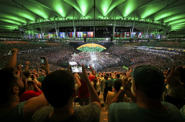 2016 Rio Olympics, Opening ceremony, Maracana, Rio de Janeiro, Brazil on August 5, 2016. Spectators cheer as members of Brazil's team take part in the opening ceremony. (Photo by Marko Djurica/Reuters)