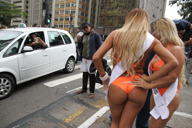 The 27 curvy candidates for this year's eagerly-awaited Miss Bumbum pageant showed off all their assets as they paraded on one of Sao Paulo's busiest streets – Avenida Paulista – for the launch promotional race on August 8, 2016. Unsurprisingly, they stopped traffic. The girls will be fighting it out for the coveted title in a public vote before being whittled down to 15 finalists for the grand finale in November. (Photo by Leo Marinho/Splash News and Pictures)